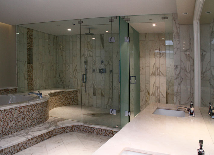 tile showers with glass doors.  ArtistCraft com